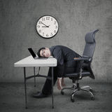 Overworked manager sleeping at desk Royalty Free Stock Photos