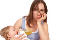 Overworked mother Stock Images