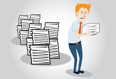Overworked office manager. worker with heap of pap Royalty Free Stock Photo