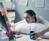 Overworked office worker Stock Images