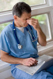 Overworked, Overstressed Doctor Stock Images