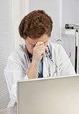 Overworked, Overstressed Female Doctor or Nurse Stock Photos