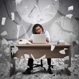 Overworked and overtime. Businessman with bored expression and clock background Stock Photo