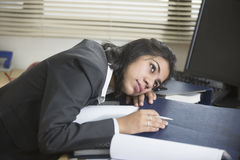 Overworked and Stressed out businesswoman Stock Photo
