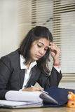 Overworked and Stressed out businesswoman Stock Image