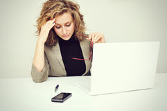 Overworked Tired Businesswoman. Overworked tired, frustrated or stressed Businesswoman sitting at computer Royalty Free Stock Images