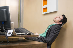 Overworked, tired young businessman sleeping Stock Images