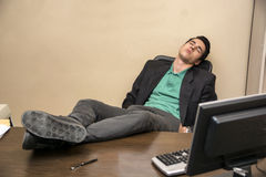 Overworked, tired young businessman sleeping at Stock Photo