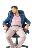 Overworked, tired young businessman sleeping on Stock Image