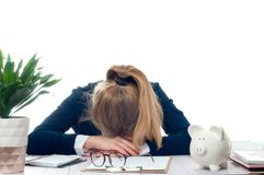Overworked and tired young woman sleeping on desk at office Stock Images