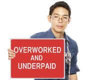 Overworked And Underpaid Stock Photos