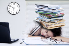 Overworked woman sleeping at workplace Royalty Free Stock Image