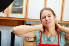Overworked woman suffering from neck pain. Stock Photos