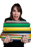 Overworked Worker. Screaming mad office worker with binders of work Royalty Free Stock Images