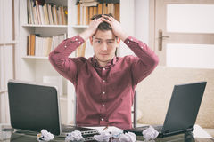Overworked young man Stock Photo