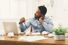 Overworking african-american employee at workplace Royalty Free Stock Photography