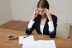 Overworking business woman Royalty Free Stock Photos