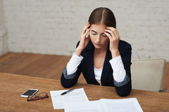 Overworking business woman Royalty Free Stock Images