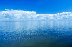 Overzees en cloudscape Stock Foto's