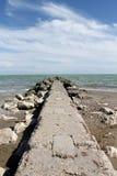 Overzees en strand Stock Foto