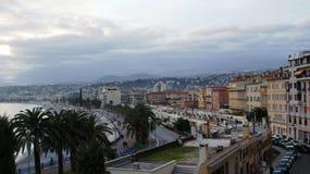 Overzees en strand in Nice Stock Foto