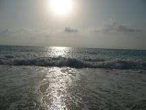 Overzees en witte zonsondergang Royalty-vrije Stock Afbeeldingen
