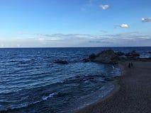 Overzees en zand: stock afbeelding