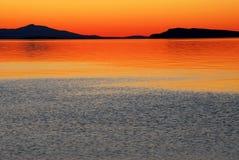 Overzees en zonsondergang stock afbeelding