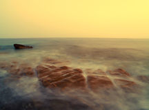 Overzees landschap bij zonsondergang Royalty-vrije Stock Afbeeldingen