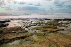 Overzees landschap, zonsondergang Stock Afbeeldingen