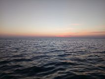 Overzees na zonsondergang Stock Afbeelding