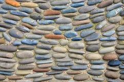 Overzeese kiezelstenen Kleine de textuurachtergrond van het stenengrint Stapel van Kiezelstenen Royalty-vrije Stock Foto
