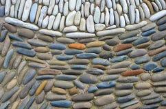 Overzeese kiezelstenen Kleine de textuurachtergrond van het stenengrint Stapel van Kiezelstenen Royalty-vrije Stock Afbeeldingen