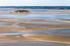 Overzeese kust bij hoogtijd Stock Foto's