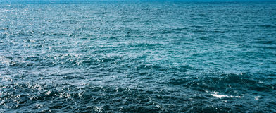 Overzeese Oceaan Blauwe Waterspiegelachtergrond Stock Fotografie