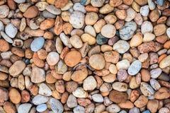 Overzeese stenen achtergrondsinaasappel Stock Fotografie