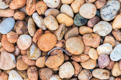 Overzeese stenen achtergrondsinaasappel Stock Foto