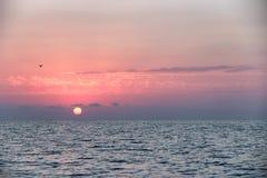 Overzeese zonsondergang Stock Afbeeldingen