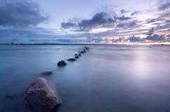 Overzeese zonsondergangfoto stock afbeelding