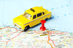 Oviedo ,Spain taxi map. Oviedo ,Spain map and a taxi toy - Travel concept Stock Photography