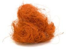 Ovillo anaranjado sobre el fondo blanco Imagen de archivo libre de regalías