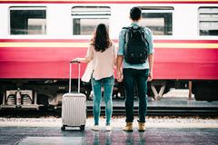 Oving couple tourist holding hand at train station. royalty free stock images