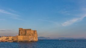 Ovo Castle in Naples, Italy at Dusk royalty free stock images