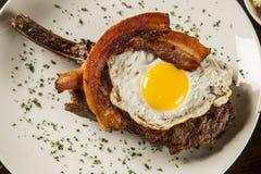 Ovo e bacon da sagacidade das costelas de primeira qualidade Fotos de Stock Royalty Free