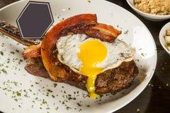 Ovo e bacon da sagacidade das costelas de primeira qualidade Fotografia de Stock Royalty Free