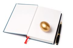 Ovo e livro dourados Imagens de Stock Royalty Free