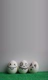 Ovos com a foto das caras para seu projeto fotos de stock royalty free