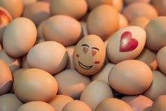 Ovos com na face do amor Fotografia de Stock Royalty Free