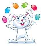 Ovos da páscoa de mnanipulação do coelho Imagem de Stock