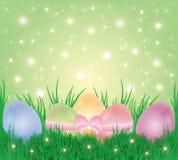 Ovos da páscoa em uma grama ilustração stock